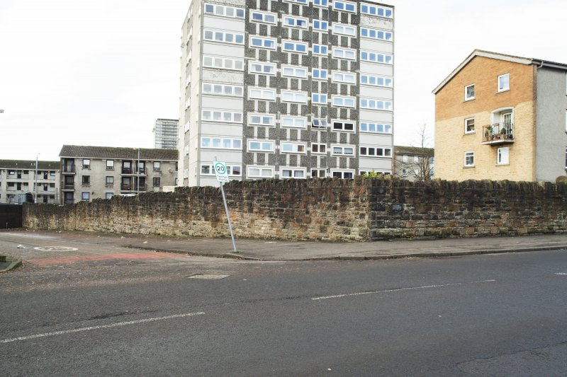 General view of the perimeter walls of the former Maryhill Barracks site, taken at the junction of Contin Place and Garioch Road from the east.