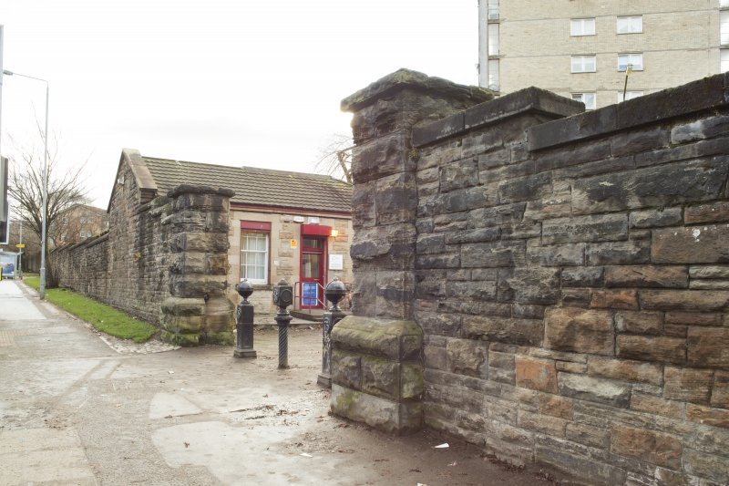 Detail of the gate piers and gatehouse within the perimeter walls of the former Maryhill Barracks site.
