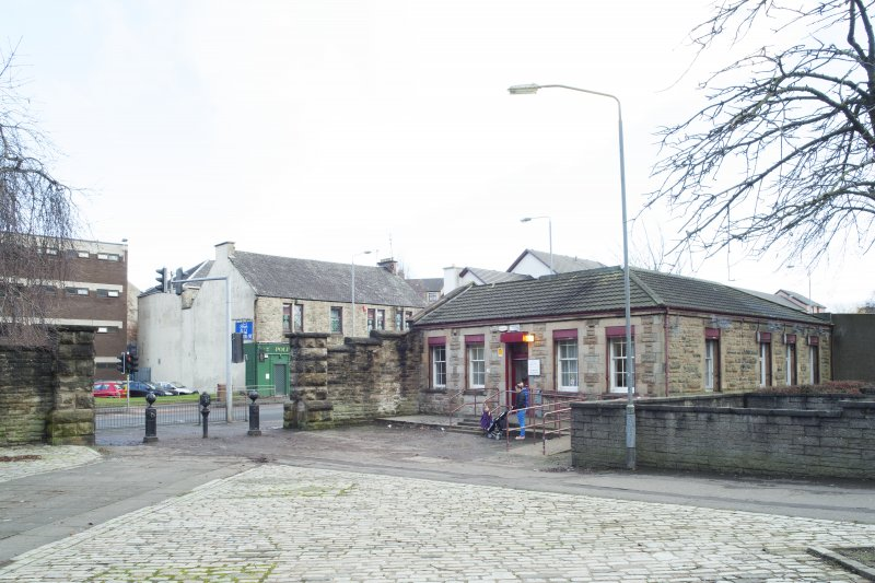 General view of the gate piers and gate house within the perimeter walls of the former Maryhill Barracks site, taken from the north west.