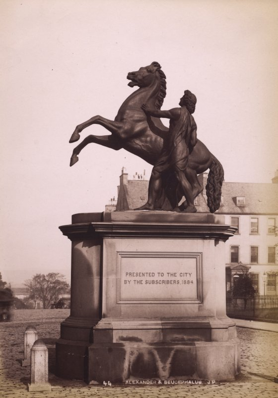 View of statue of man with horse, St Andrews Square, Edinburgh. Now in the courtyard of City Chambers.  Titled: 'Alexander & Bucephalus J.P.' PHOTOGRAPH ALBUM No. 195: George Washington Wilson Album, p.133.