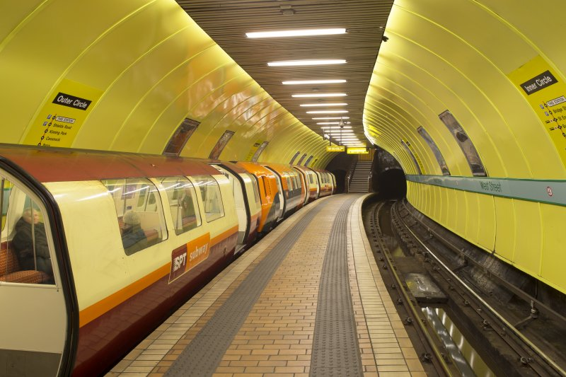 View looking along the island platform and tracks of West Street subway station, with a train waiting at the Outer Circle platform