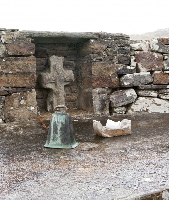 Detail of bell and carved cross on altar at east end of church
