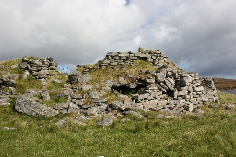 The broch from the SW showing the remodelled entrance and (in the centre) the position of the guard cell, part of the roof having collapsed.