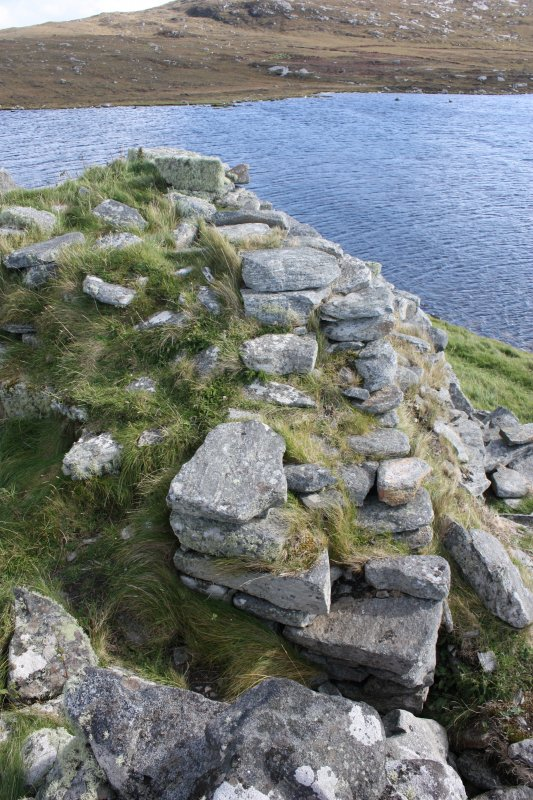 The internal broch wall at the entrance; this section has probably been completely remodelled. Taken from the NW.