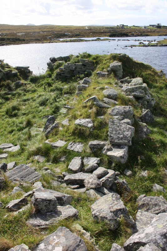 The NW wall of the later building, rebuilt from and overlying the thicker broch wall.