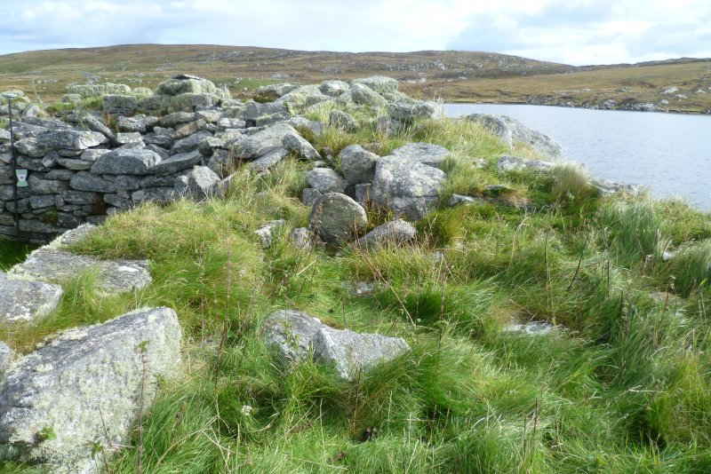 A smaller room was set here, between the broch wall and the later building to the left.