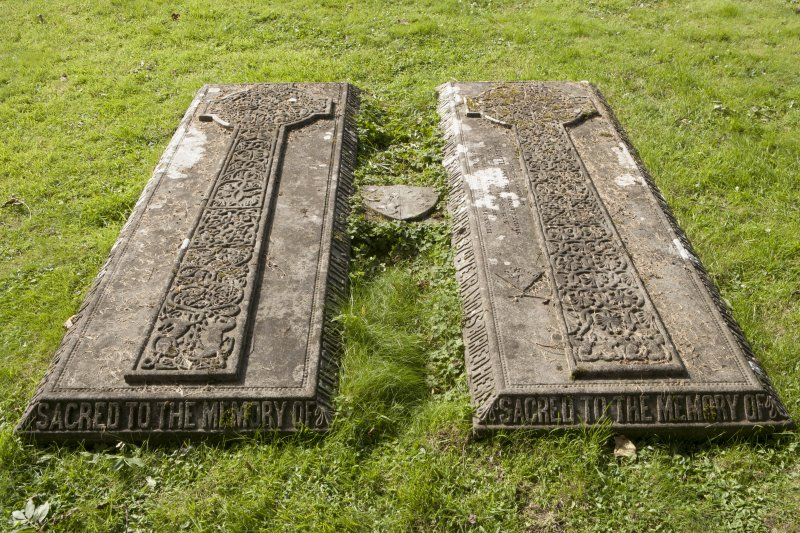 Detail of pair of gravestones with carved crosses.