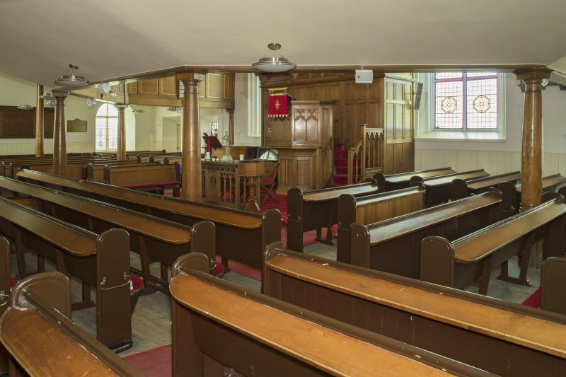 Interior. View from under gallery, looking across the ground floor pews towards the sanctuary, taken from the north west
