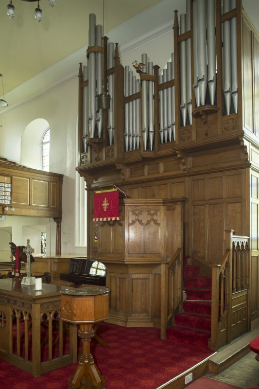 Interior. View of the sanctuary area, with the raised central pulpit set onto the organ and communion table and font to fore