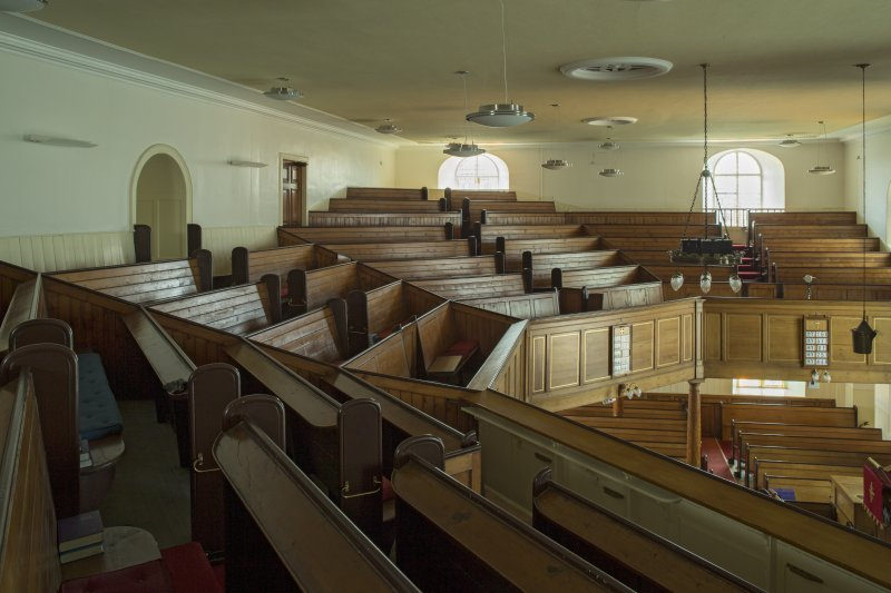 Interior. View looking across the pews of the gallery, taken from the west