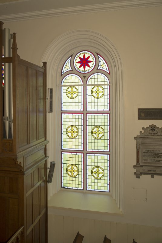 Interior. Detail of stained glass window to west of pulpit