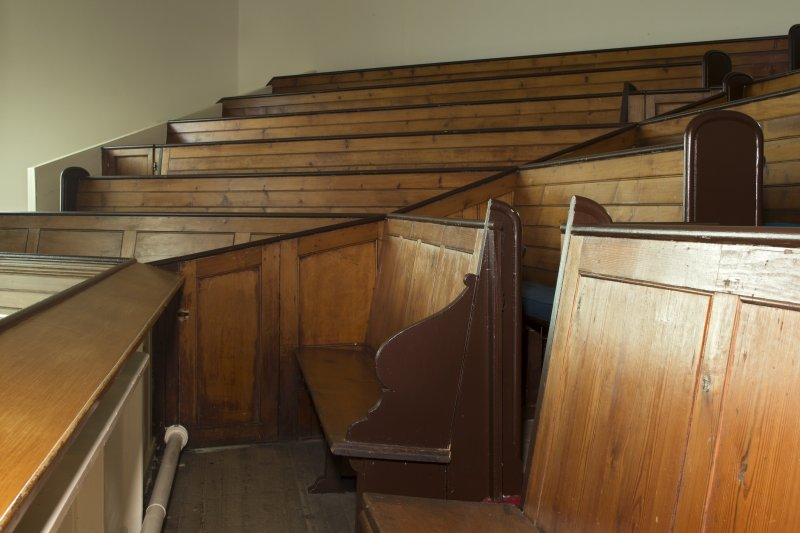 Interior. Detail view of pews and panelling within gallery
