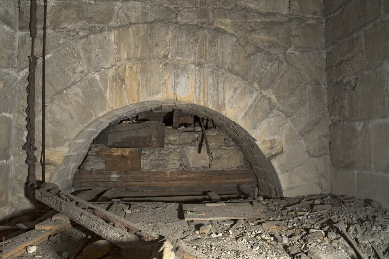 Interior. Detail view of c13th arch at first floor level of the tower's east wall, now masked by panelling and the gallery within the main worship space