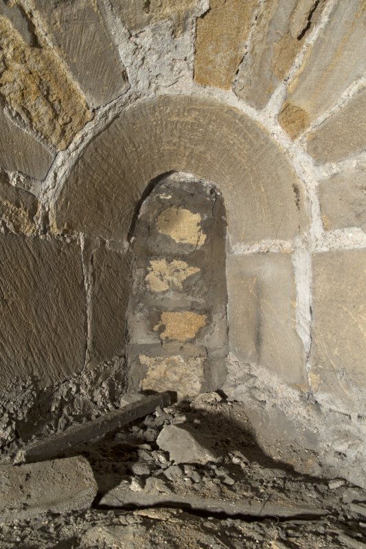 Interior. Detail of blocked c13th arched window above entrance door of the tower,