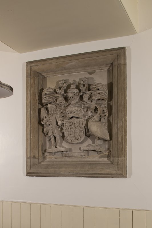 Interior. Detail of stone carved armorial panel with coat of arms