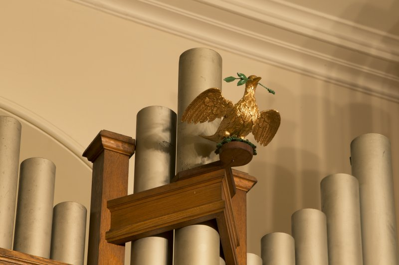 Interior. Detail of dove with olive branch mounted on organ pipes