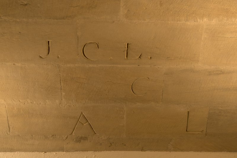 Interior. Detail of initials carved into wall of entrance hall