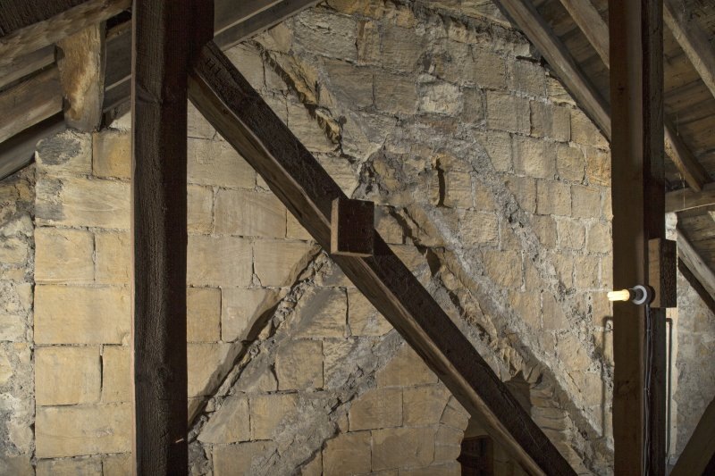 Interior. View within the roof space of the church, showing the raggles of earlier roofs on the tower's east face, 2nd stage
