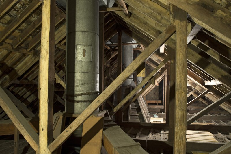 Interior. View showing roof trusses and ducting for ceiling vents within the church roof space.