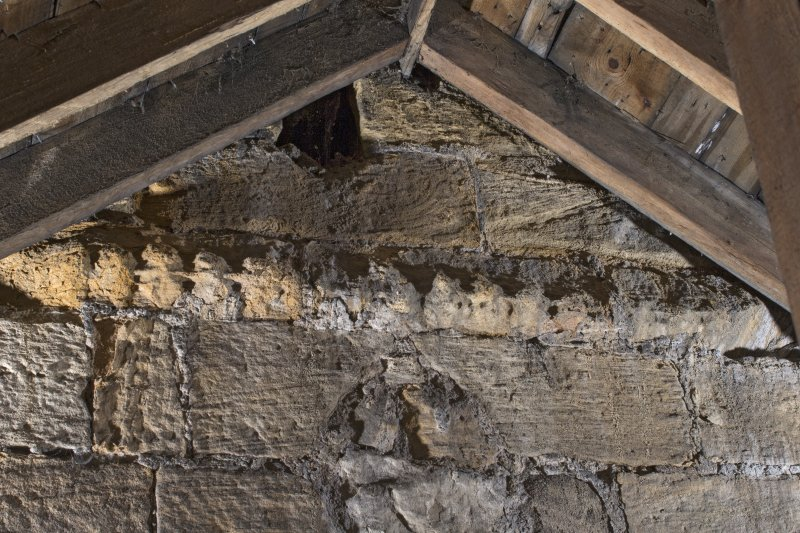Interior. View within the roof space of the church, showing detail of the decorative string course on the tower's east face, 2nd stage
