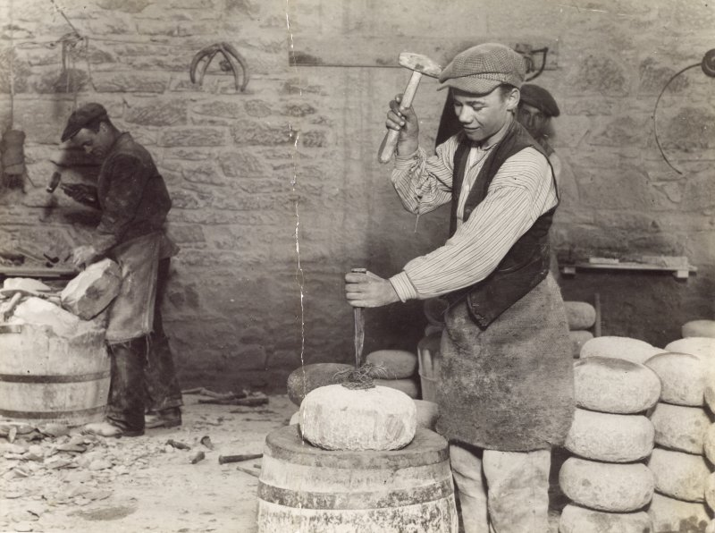 Interior. Former Roughing Out Shed.  Process: Roughing out. Roughing out and boring a curling stone by hand c.1925, Willie Cairns (left), 'Scottie' Willison (right)