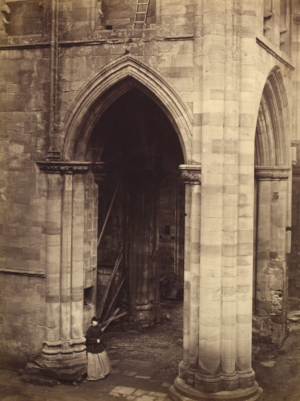View of south transept from west showing lady standing, Melrose Abbey.