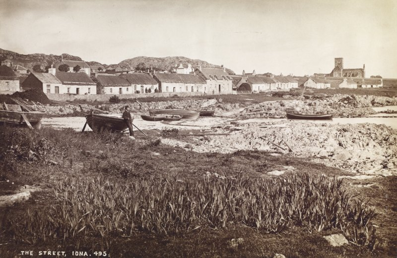 Titled 'The Street, Iona',  showing the landing place and the village, with the abbey in the background, from the SE, photographer not identified but may be J. V.  Mounted.