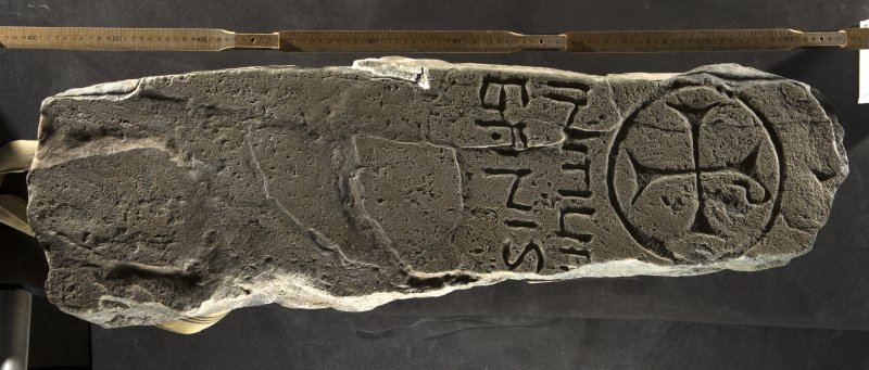 Inscribed cross slab (H.S. no. KMD001) flash with scale