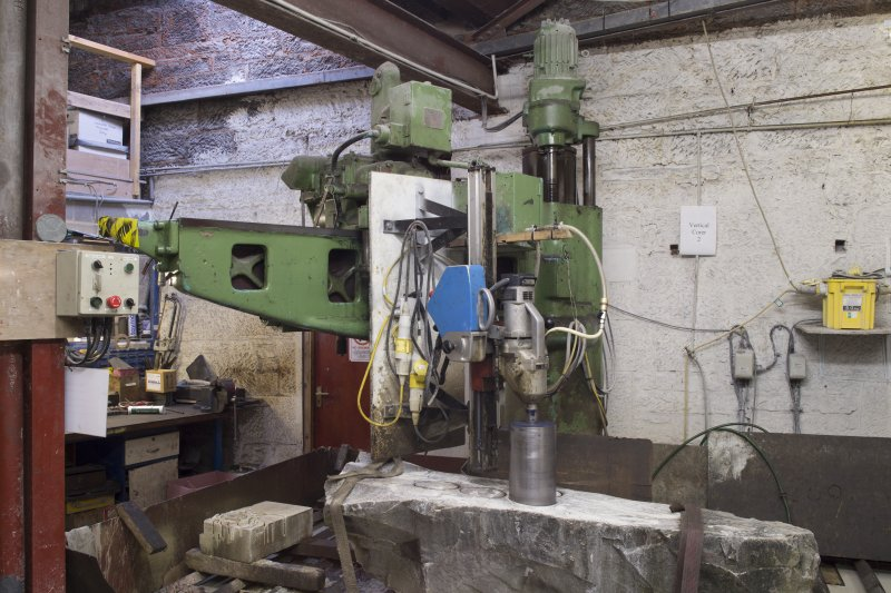 Interior. Main Workshop. Vertical Corer no.2 cutting ailserts from block of blue hone ailsa.