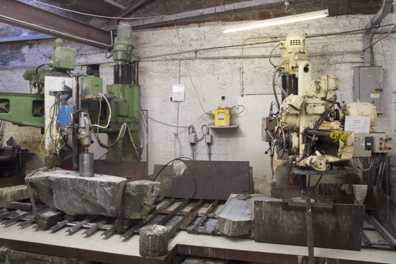 Interior. Main Workshop. Vertical Corer no.1 cutting blocks or rough outs for curling stones from block of common ailsa granite.