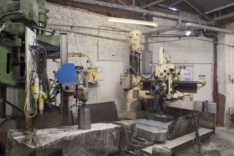 Interior. Main Workshop. Vertical Corer nos. 2 and 1 cutting ailserts and blocks or rough outs for curling stones from blocks of blue hone (ailsert) and common ailsa granite.
