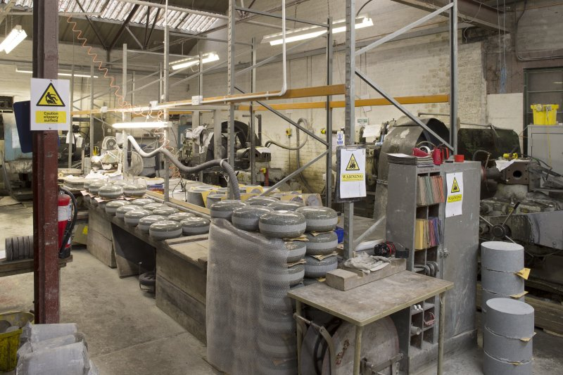 Interior. Main Workshop. Quality Control, matching and finishing area. Note the rough-outs on the right as they have come from Vertical Corer no. 1. Lathes 2 and 3 are visible in the background. Lathe 2 cuts the 'pockets' or recesses for the ailserts and Lathe 3 rough shapes the shoulder profile and reduces the rough-out  to 134mm in depth.