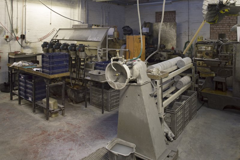 Interior. Former Turning Shop. Now Giftware. This section was built in 1949 and was originally an open courtyard area. Here we see the polisher for giftware. to the right is ailsert storage. The machine on the left is the six spindle machine that lishes the giftware.
