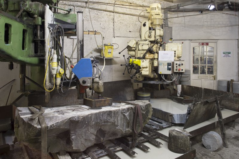 Interior. Main Workshop. View of Corers 2 (ailserts) and 1 (rough outs). These drills produce the two components of the curling stone.