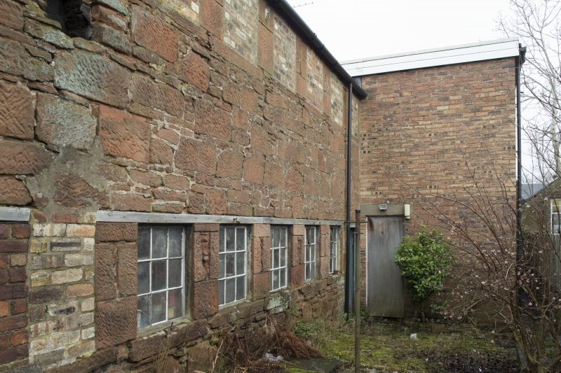 View of rear of east range. Former workshop. Disused and not part of the Curling Stone Factory. the extension is Leefield House which was partly used for Finishing (ground floor).