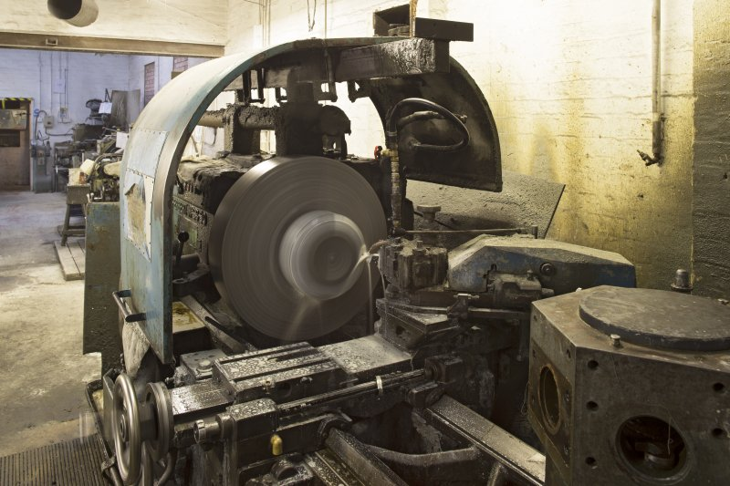 Interior. Main Workshop. No 4 lathe (Herbert 9C/30 lathe), final diamond cutting. The curling stone profile is 90% complete after cutting on this lathe.