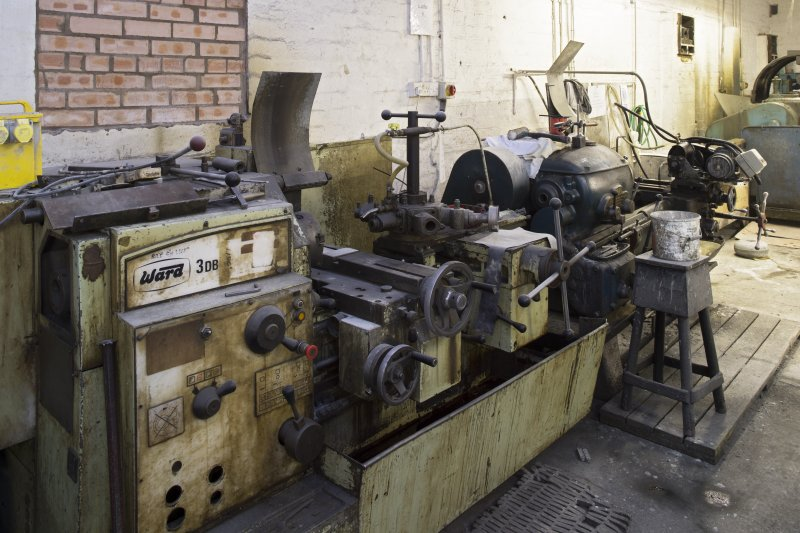 Interior. Main Workshop. Lathe no.6 (shaping some larger size giftware and undercuts small size giftware (disk recess fittings). Lathe no.5 (banding machine) is on the right.