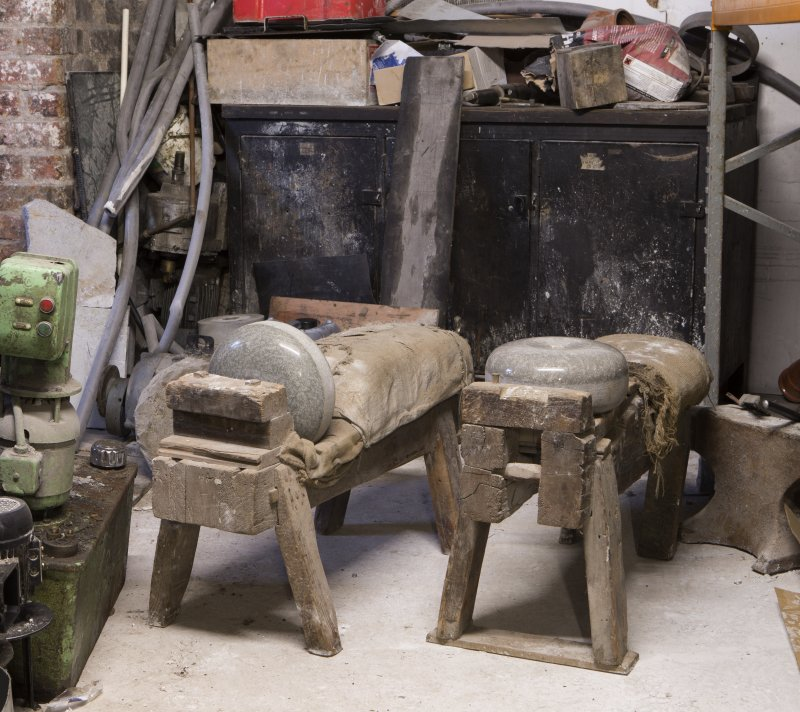 Interior. Rough Out Shed. Ground floor. View of 'cuddies'. The cuddy on the left was for cutting the strike band on the curling stone (also known as belting). On the right, the cuddy for cutting square counter sink for handle fittings. Disused since 1980s.