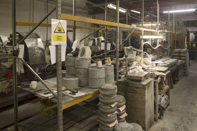Interior. Main Workshop. View of quality control and ailsert insertion into curling stone rough block area.