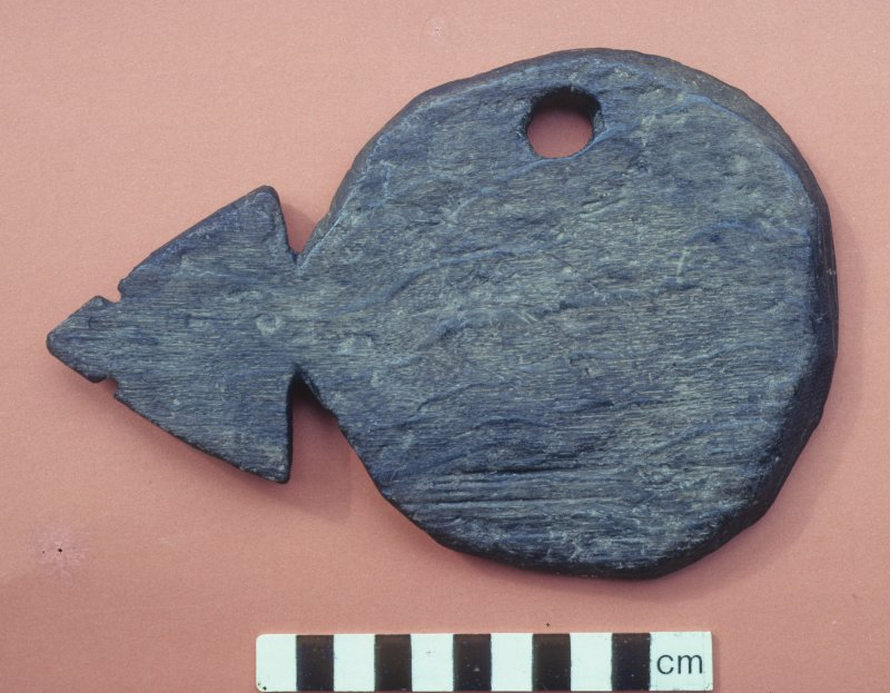 Probable oar-port shutter from a 13th-century context. Such devices were intended to keep the oar-ports of clinker-built ships weather-proof when not in use. They were mounted on pivots inside the hul ...