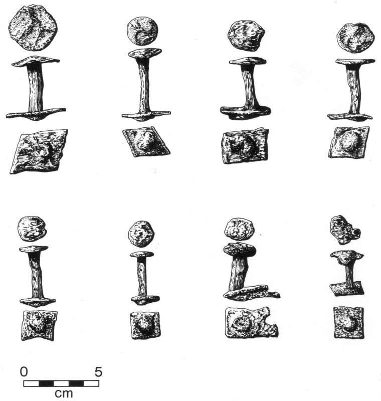 A selection of wrought-iron rivets and roves (see Perth15). These were primarily  associated with clinker boatbuilding, but were also used for studding doors. Scale in cm.