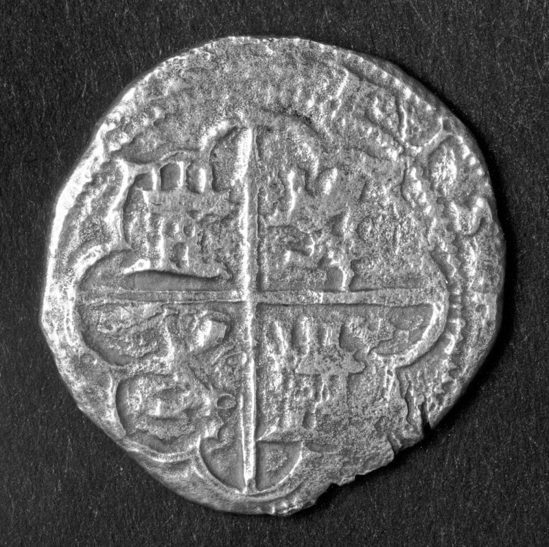 Silver 4-real coin of Philip II minted at Toledo (reverse).