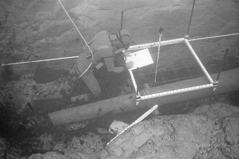 Tony Long recording the bronze media culebrina in situ. Note the longitudinal datum tape against which the 1-m drawing-frame is positioned (1977).