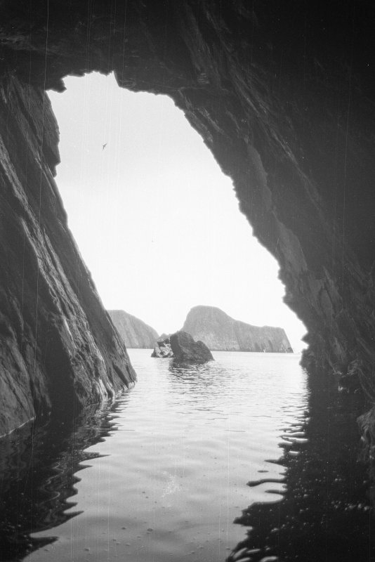 View from inside the cave at the head of Stroms Hellier, looking past the central reef towards Sheep Rock (1977).