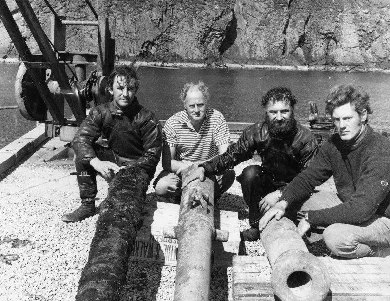 The 1970 team on the pier at North Haven, Fair Isle, with guns recovered from the wreck. From left: Simon Martin, Sydney Wignall, Colin Martin and Chris Oldfield. (photographer unknown)