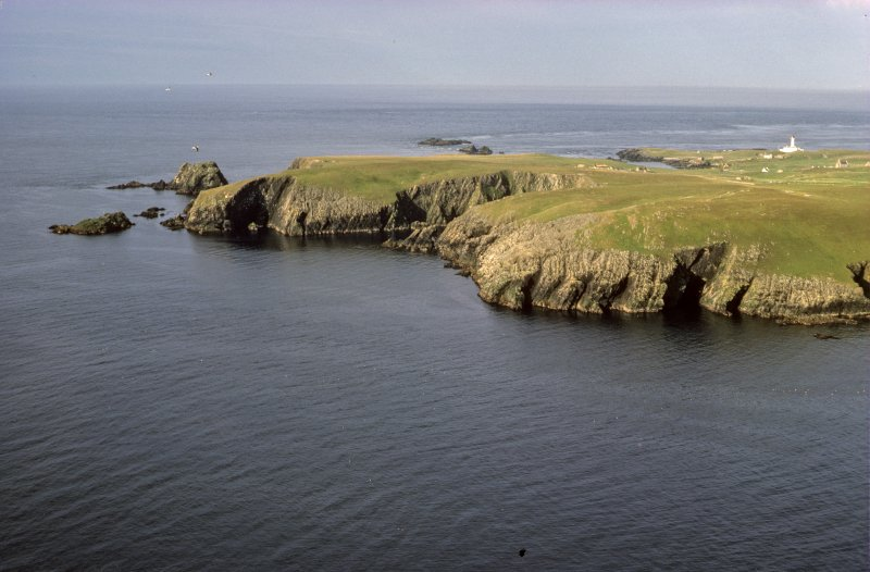 The SE end of Fair Isle, seen from the top of Sheep Rock. The overhanging cliff of Stroms Hellier, where the Gran Grifón was wrecked, is seen in shadow on the left with Swartz Geo to its right.