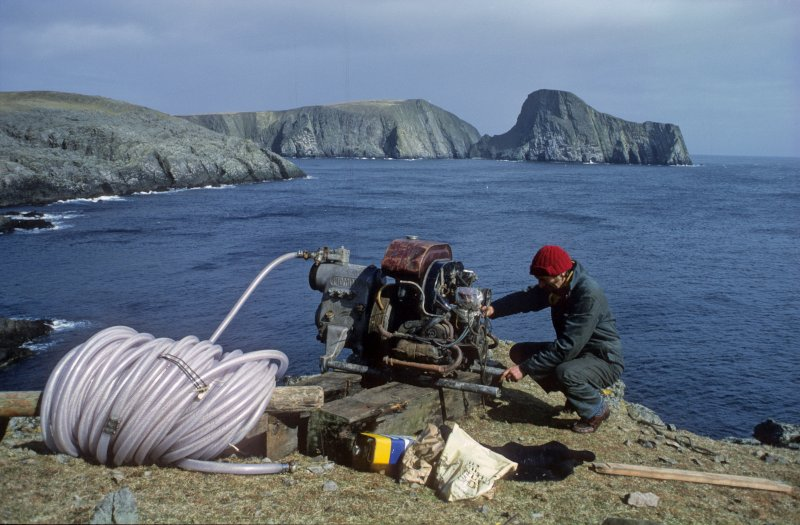 The airlift compressor and hose set up on the cliff-top by Tony Long. Sheep Rock in the background (1977).