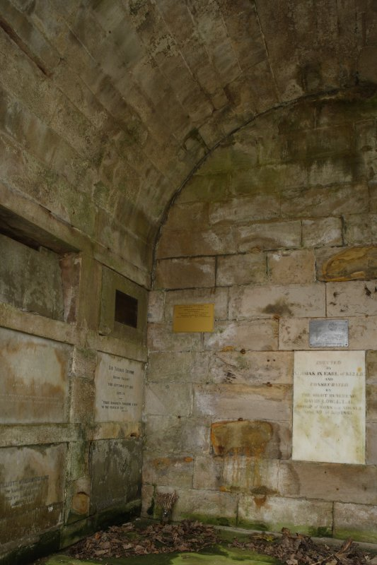 View into west corner of the Cambo estate mausoleum, showing the back wall and full height of the stone vault.