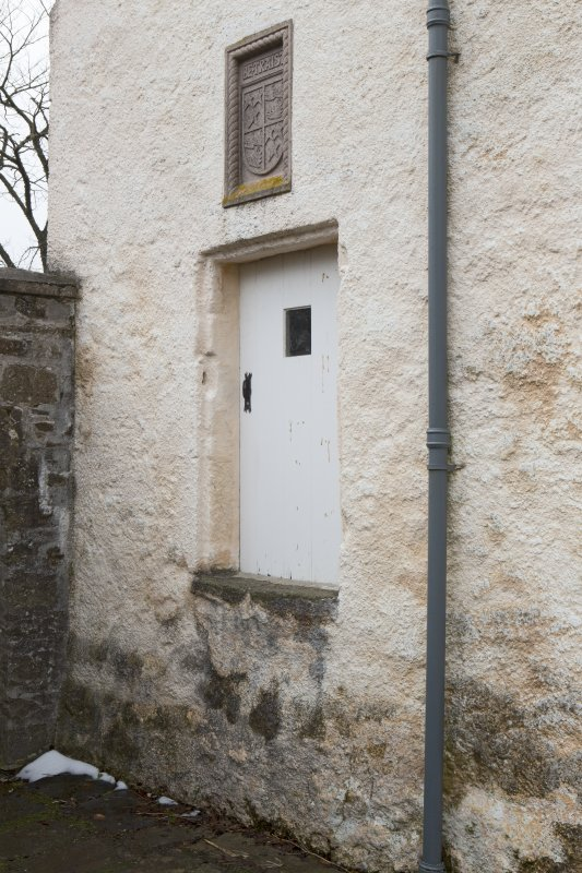 View of entrance to tower with armorial panel above