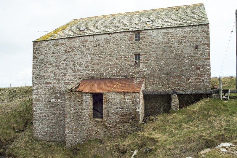 West elevation of the mill, with wheel house at lower level and lade feeding from ground level.